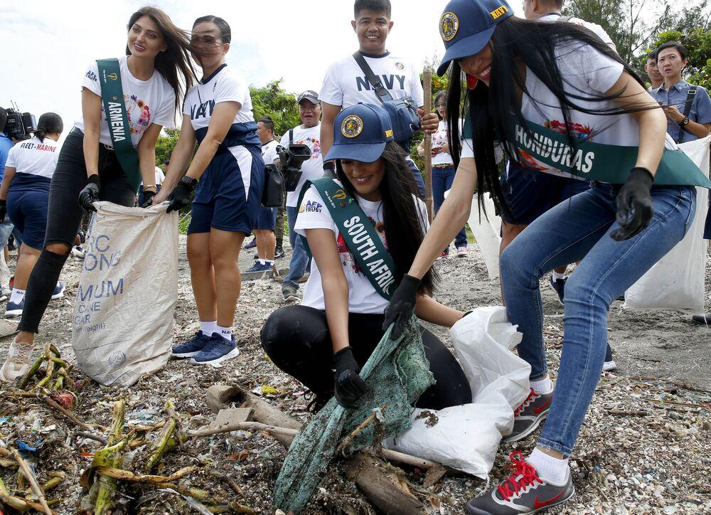 Bu yıl Miss Earth (Yeryüzü Güzeli) unvanı için yarışacak olan güzel adaylar, Filipinler'de yarışma finali  öncesi düzenlenen çevre koruma etkinliği sırasında.