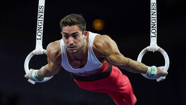 23'ncüsü düzenlenen Artistik Cimnastik Dünya Şampiyonası'nda İbrahim Çolak, halka aletinde altın madalya alarak cimnastikte dünya şampiyonluğuna ulaşan ilk Türk sporcu oldu. - Sputnik Türkiye