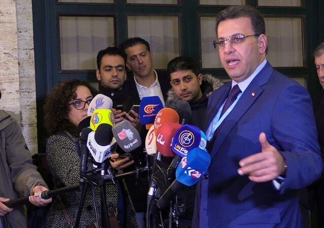 Suriye Anayasa Komitesi'nde Suriye Hükümeti'ni temsil eden Eş Başkanı Ahmed Kuzbari