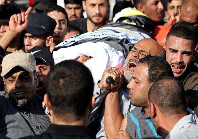 'İslami Cihad'ın askeri kanadı 'Kudüs Seriyyeleri'nin önde gelen komutanlarından ve İsrail'in saldırısında öldürülen Beha Ebu'l Ata'nın cenazesi