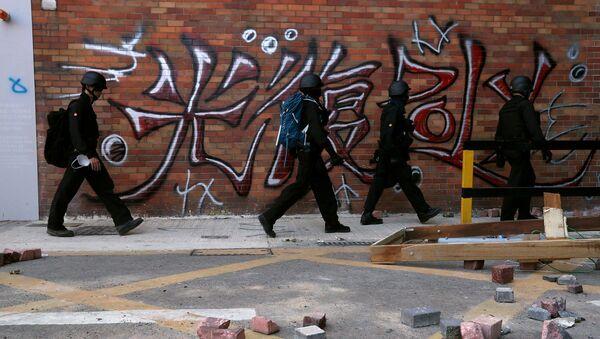 Hong Kong'da üniversite işgali sonlandı: Polis kuvvetleri temizlik için kampüse girdi - Sputnik Türkiye