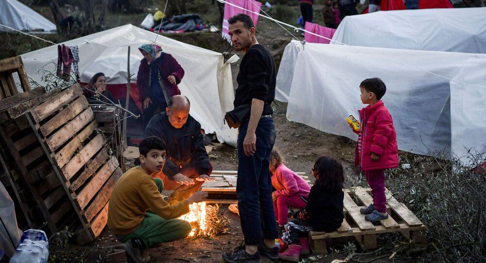 Uluslararası Göç Örgütü geçtiğimiz ay, Yunanistan'ın ana kamplarında bulunan mülteci sayısının kapasitesinin aştığını açıklamıştı.  Fotoğrafta: Midilli Adası'ndaki Moria mülteci kampından bir kare.