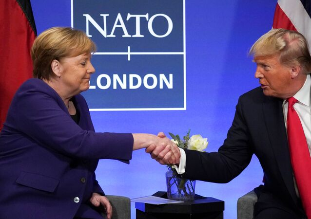 U.S. President Donald Trump shakes hands with Germany's Chancellor Angela Merkel during a bilateral meeting at the sidelines of the NATO summit in Watford, Britain, December 4, 2019. REUTERS/Kevin Lamarque