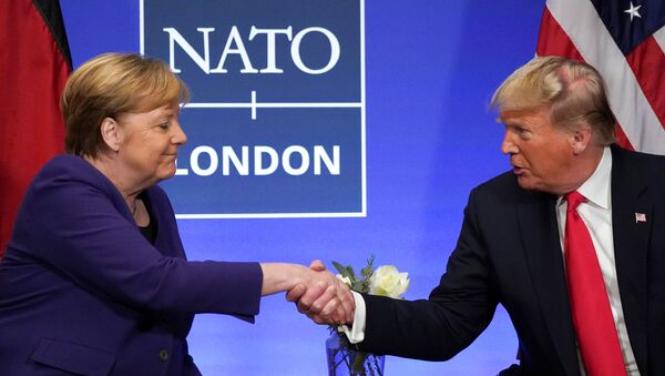 U.S. President Donald Trump shakes hands with Germany's Chancellor Angela Merkel during a bilateral meeting at the sidelines of the NATO summit in Watford, Britain, December 4, 2019. REUTERS/Kevin Lamarque - Sputnik Türkiye