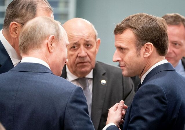 Russian President Vladimir Putin, French Foreign Minister Jean-Yves Le Drian and French President Emmanuel Macron attend the Libya summit in Berlin, Germany