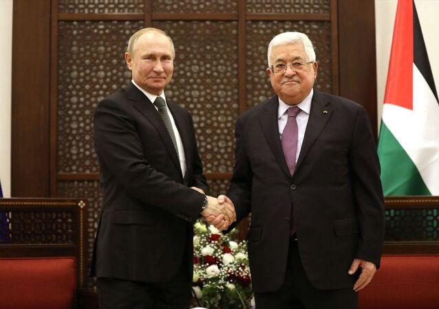 Filistin Devlet Başkanı Mahmud Abbas, Batı Şeria'nın Beytüllahim kentine gelen Rusya Devlet Başkanı VladimirPutin ile Başkanlık Sarayı'nda bir araya geldi.