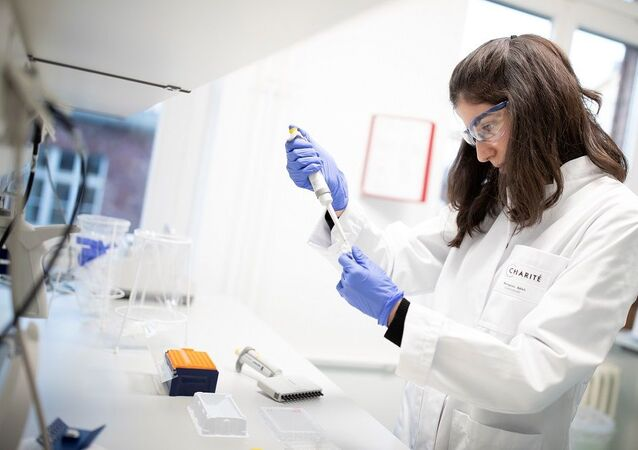 An employee of the virology department of the Charite hospital prepares a test for the new coronavirus in Berlin