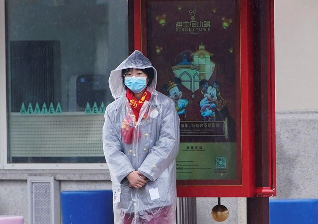 A member of staff outside the Shanghai Disney Resort in Shanghai, China