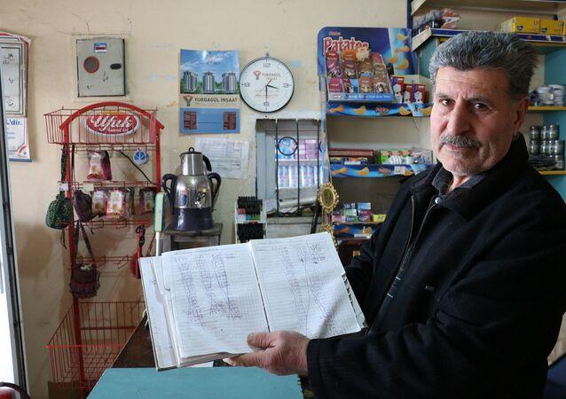 Kahramanmaraş'ta iki kişi veresiye defterindeki 5 bin liralık borcu ödedi