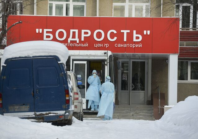 Medical staff wearing protective gear wait for Chinese citizens, who are taken to the quarantine center based at sanatorium Bodrost (Cheerfulness) in Yekaterinburg, Russia. 60 healthy Chinese citizens are isolated in sanatorium is case anyone of them has early signs of Coronavirus.