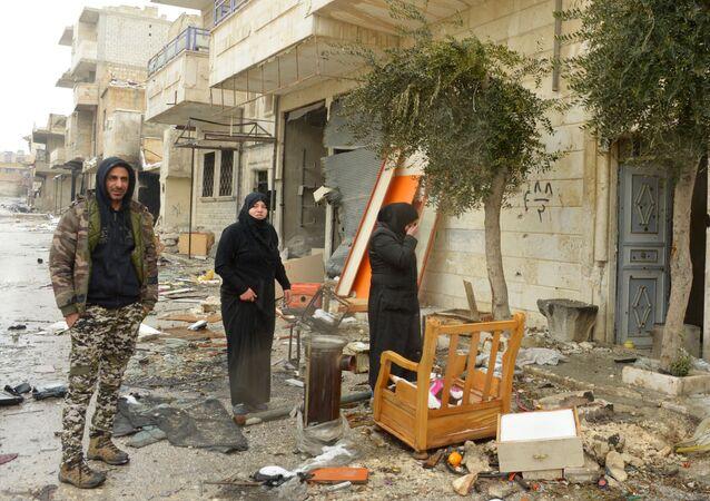 Şiddetli çatışmalara sahne olmuş kentte çok sayıda bina ve ev hasar gördü.