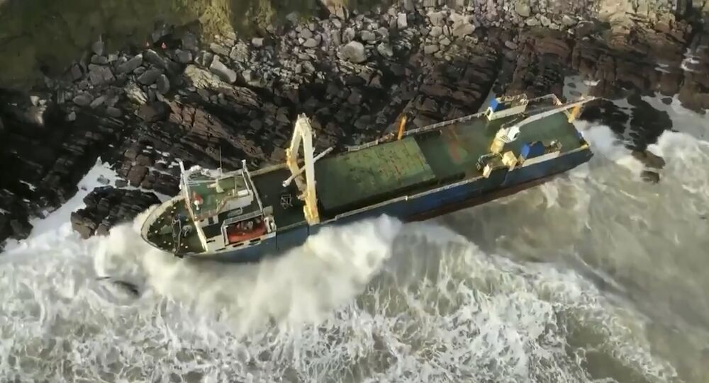 Undated image released Monday Feb. 17, 2020, by Irish Coast Guard showing an abandoned cargo ship the MV Alta, that has washed up on the coast of County Cork, near Ballycotton, southern Ireland.  The MV Alta is believed to have had 10 crew members aboard who were rescued by the US Coast Guard.  Since September 2018, the ship has been drifting with no crew aboard, and it was last seen off the coast of West Africa before being washed up in southern Ireland during Storm Dennis.
