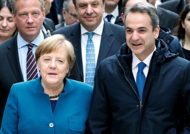 AlmanyaBaşbakanı Angela Merkel ile Yunanistan Başbakanı Kiriyakos Miçotakis, Berlin'deki Alman-Yunan Ekonomi Forumu'na katılırken