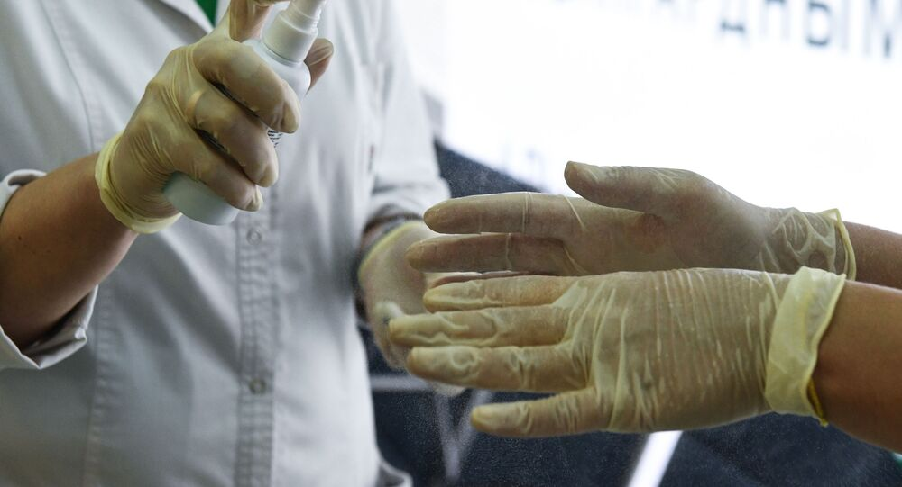 Medics disinfect their hands at Tolmachevo airport amid coronavirus outbreak, in the Siberian city of Novosibirsk, Russia.