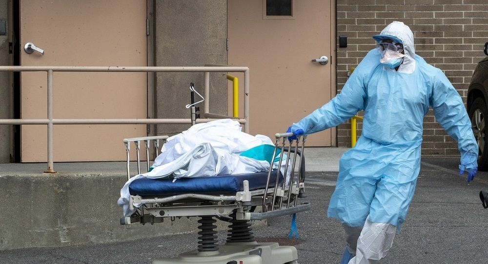 Medical personnel wearing personal protective equipment to protect from the new coronavirus remove a body from the  Wyckoff Heights Medical Center to refrigerated containers parked outside, Thursday, April 2, 2020 in the Brooklyn borough of New York.  (AP Photo/Mary Altaffer)