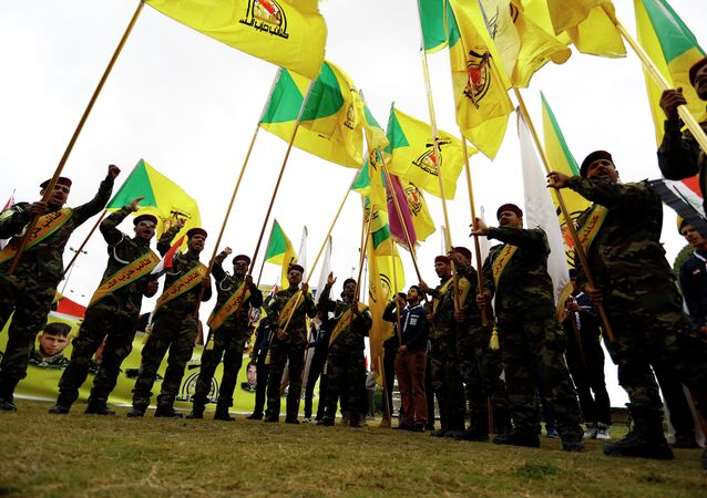 Members of the Hezbollah Brigade in Iraq, a Shiite movement supporting the Iraqi government forces in the ongoing clashes against Islamic State