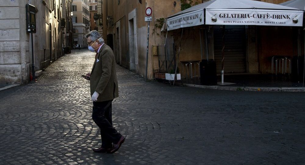 A man walks in Piazza Navona in Rome on April 16, 2020, during the lockdown of the country to curb the spread of the COVID-19 epidemic caused by the new coronavirus. (Photo by Tiziana FABI / AFP)