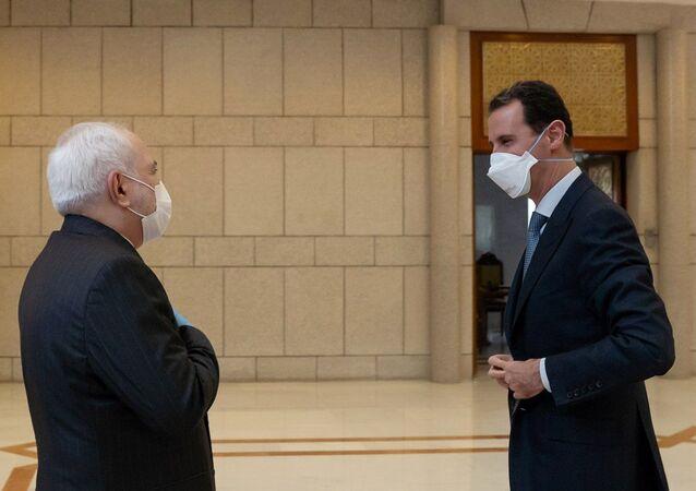 İran Dışişleri Bakanı Muhammed Cevad Zarif ve Suriye Devlet Başkanı Beşar Esad