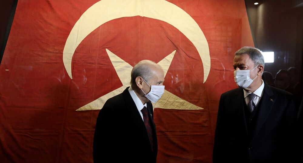 Milli Savunma Bakanı Hulusi Akar ve MHP Genel Başkanı Devlet Bahçeli