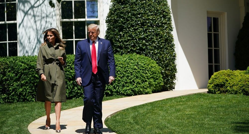US President Donald Trump and First Lady Melania Trump arrive to take part in a tree planting ceremony to mark Earth Day and Arbor Day on the South Lawn of the White House in Washington