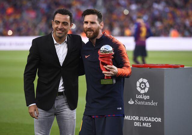 Lionel Messi- Xavi