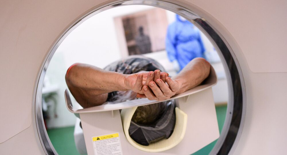 A patient is being made a computer tomography (CT) at Vinogradov hospital where patients suffering from the coronavirus disease are treated, in Moscow, Russia.