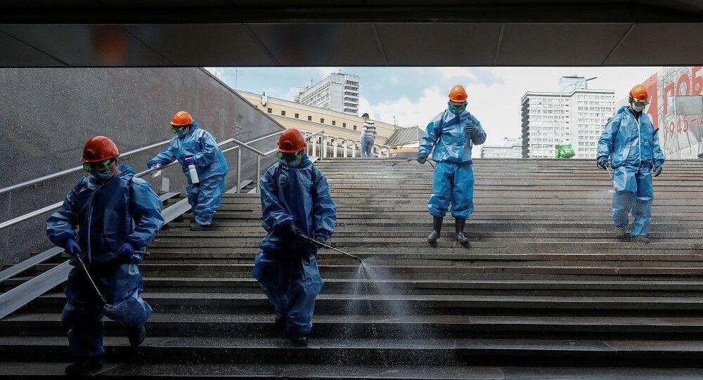 Specialists wearing protective gear spray disinfectant while sanitizing an underground passage amid the outbreak of the coronavirus disease (COVID-19) in Moscow, Russia May 16, 2020. REUTERS/Shamil Zhumatov