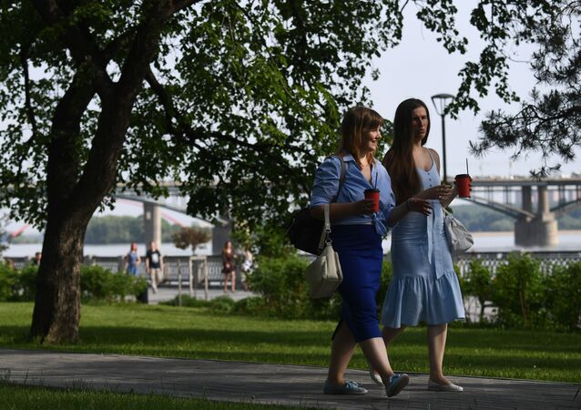 People enjoy a sunny day on the embankment of the Ob River in Novosibirsk, Russia. Parks have been reopened in Novosibirsk from May 12, as the local government softens lockdown rules during the outbreak of the coronavirus disease.