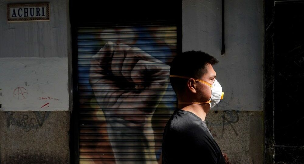 A man wearing a protective mask walks on a street amid the coronavirus disease (COVID-19) outbreak in Madrid, Spain, May 20, 2020. REUTERS/Juan Medina