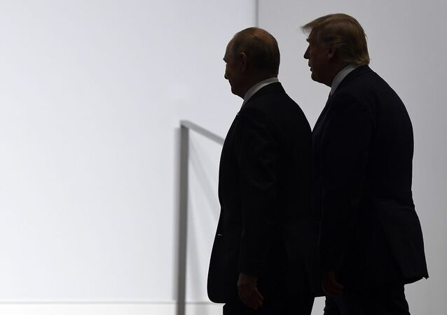 President Donald Trump and Russian President Vladimir Putin walk to participate in a group photo at the G20 summit in Osaka, Japan, Friday, June 28, 2019. (AP Photo/Susan Walsh)