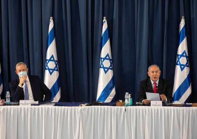 Israeli Prime Minister Benjamin Netanyahu and Israeli Defense Minister Benny Gantz attend the weekly cabinet meeting at the Ministry of Foreign Affairs in Jerusalem, June 14, 2020