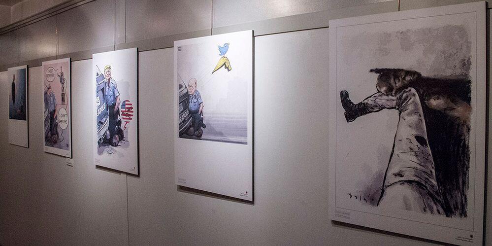 Tahran'da düzenlenen 'Nefes Alamıyorum' karikatür sergisinden bir kare