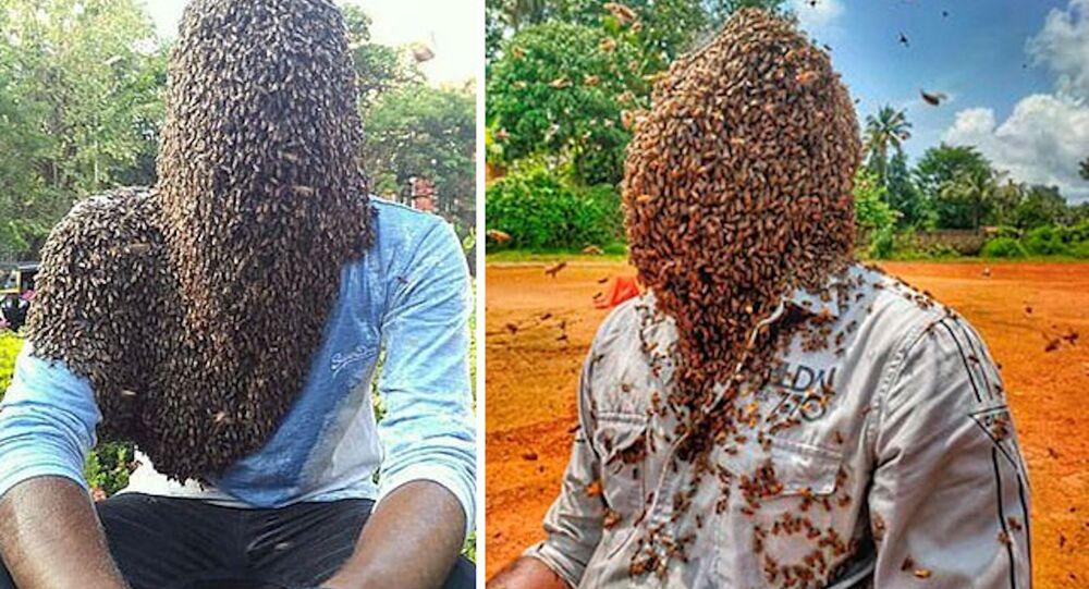 Hindistan'da arıcılık yapan Nature M.S. olarak bilinen 24 yaşındaki genç, 60 bin arının kafasında durmasına izin verdi. Nature ayrıca 4 saat 10 dakika boyunca arıları kafasında tutarak Guinness Rekorlar Kitabı'na da girdi.