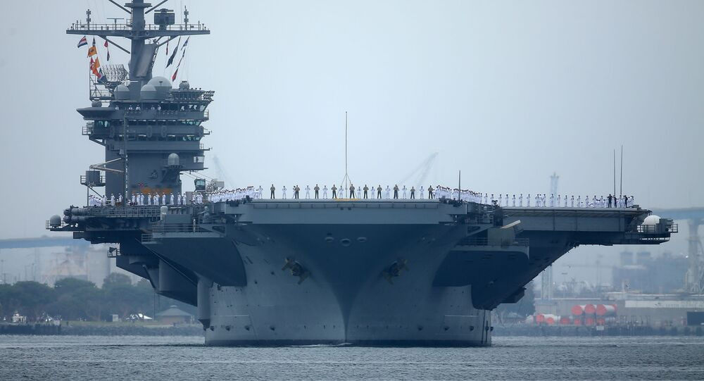FILE PHOTO: Sailors man the rails as aircraft carrier USS Nimitz with Carrier Strike Group 11, and some 7,500 sailors and airmen depart for a 6 month deployment in the Western Pacific from San Diego, California, U.S., June 5, 2017. REUTERS/Mike Blake/File Photo