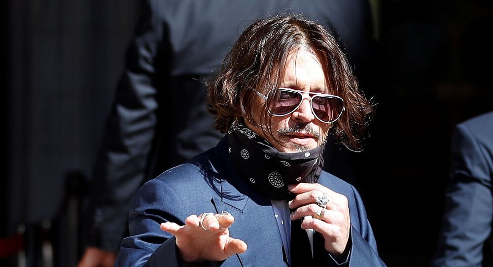 Actor Johnny Depp arrives at the High Court in London, Britain July 7, 2020. REUTERS/Peter Nicholls