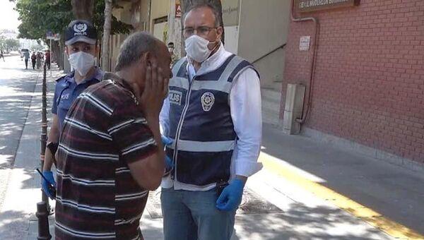 Maskesiz polise yakalandı, ceza kesilince kendini tokatladı - Sputnik Türkiye